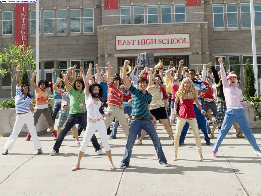 """The cast of High School Musical 2 performs """"What Time is it?"""" in front of East High."""