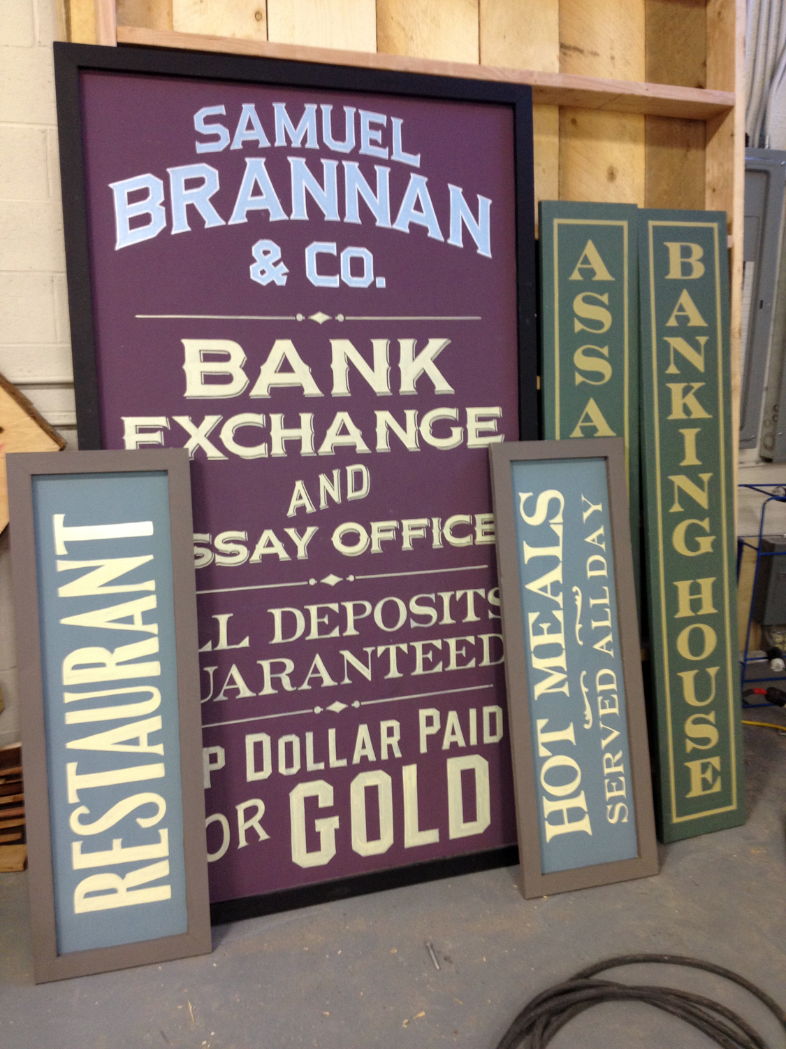 Some of the hundreds of hand painted signs we prepared waiting to go to set.