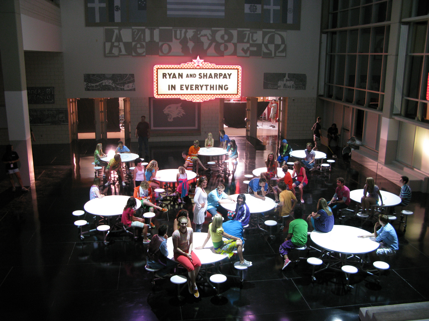 "Another great moment during ""I want it All"" involved a very Busby Berkeley moment involving dancers rotating custom built cafeteria tables with a central pivot."