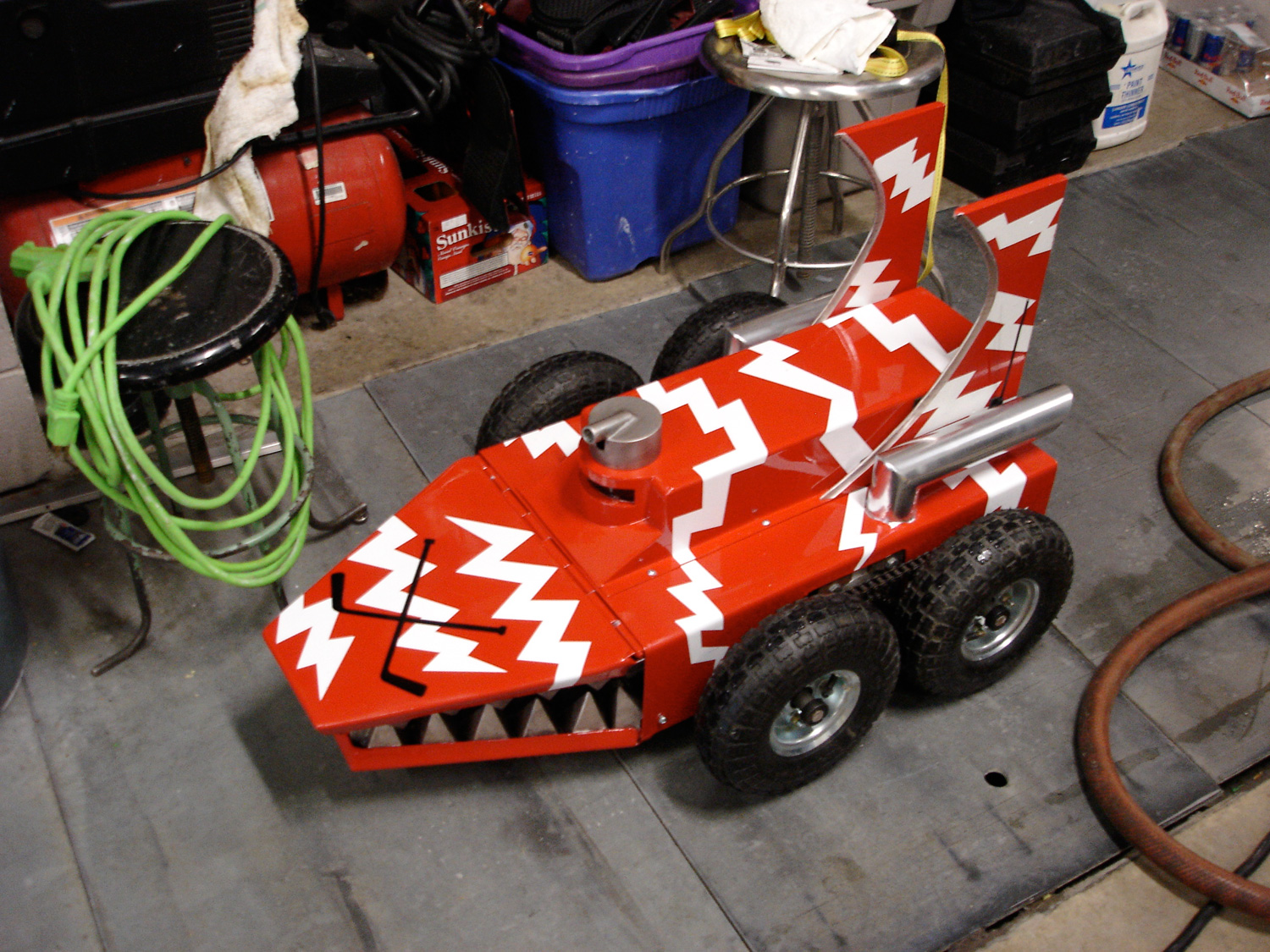 A tinkerer little brother's battle bot we made which losses a fight to a Zamboni.