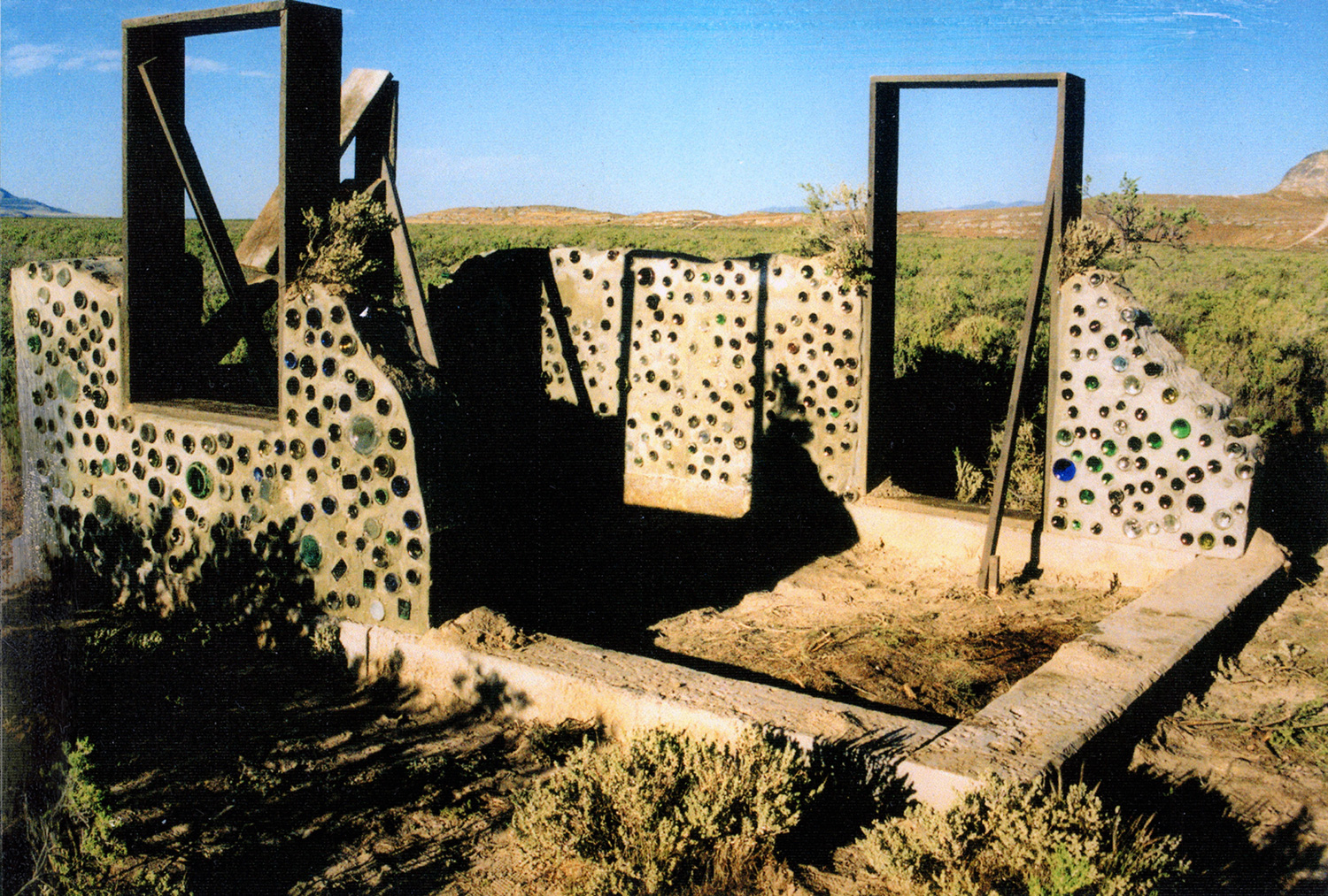 """The """"Bottle House"""" was a multi-staged set piece set in the bleak desertthat helped describe the arc from youthful optimism to neglect toeventual abandonment."""