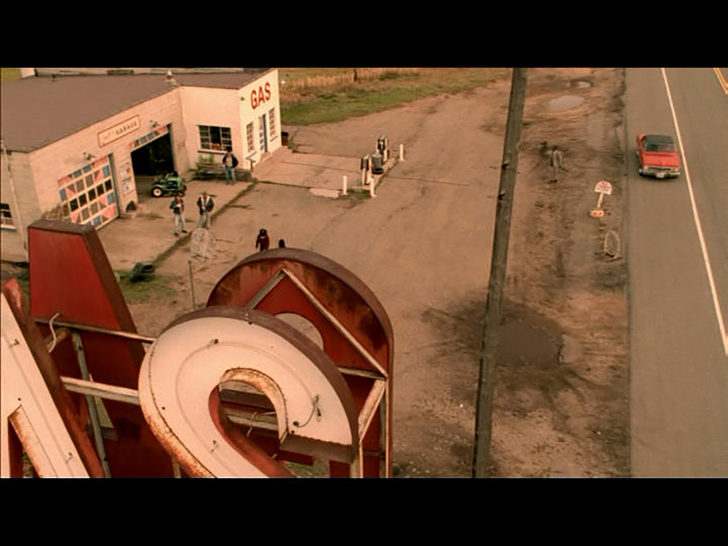 Crane shot over Cuch's (Wes Studi) Garage on the edge of the Three Nations reservation.