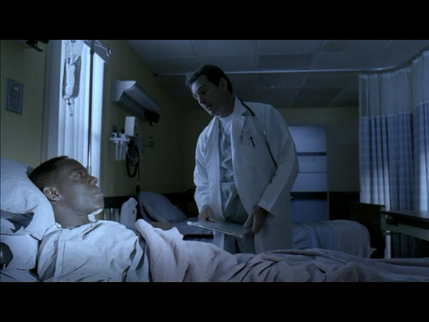 Mr. Williams (James McDaniel) recuperating after a major car accident with Dr. Toomey (Steve Burleigh) inthe Three Nations Medical Clinic stage set.