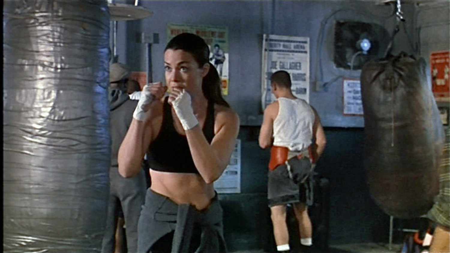 Lady assasin Andy (CLaudia Christian) in her gritty boxing gym, stage set.