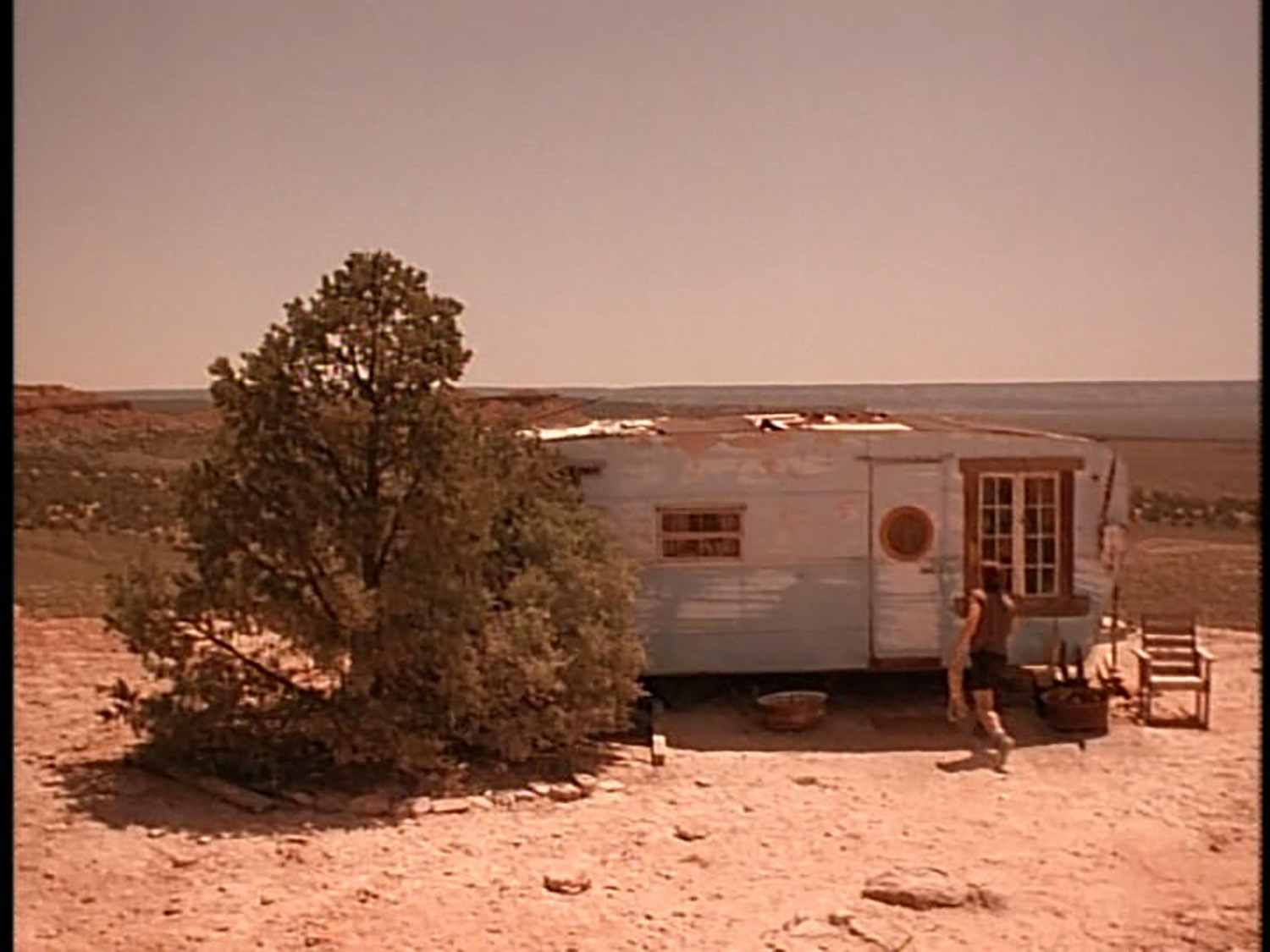 Shot of Wa Tho Huck's (Russell Means) humble trailer.
