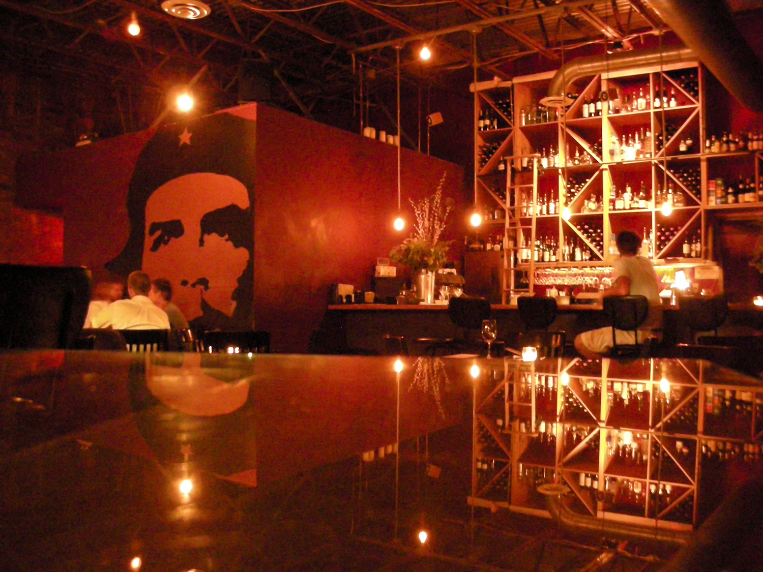 Louise Hannig, owner of the Red Door, asked me for some ideas as she neared completion of her now famous bar. I suggested overwhelming the small space with an oversized graphic of Che. Louise loved it, and a whole identity for the bar was born.