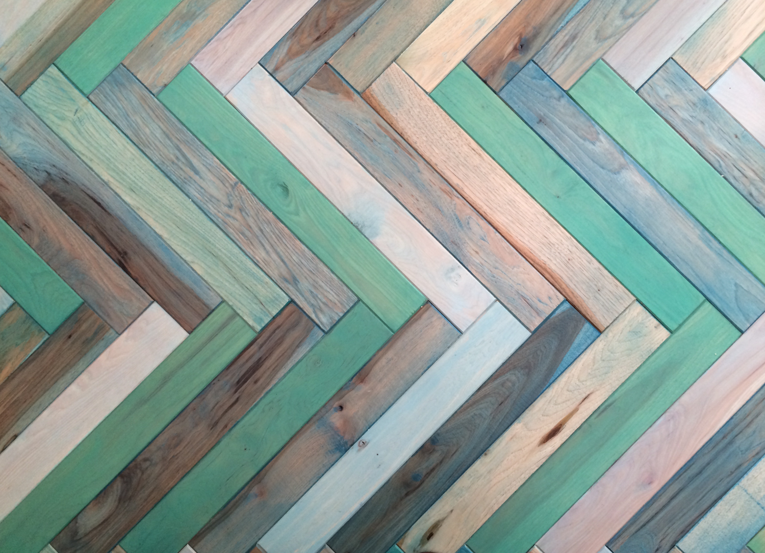 The client brought us an image of a daring museum space in Germany that featured an acid green rubber floor. I offered a more regionally appropriate, western vernacular idea of a herringbone turquoise floor. They loved the idea, and went for it on the spot.