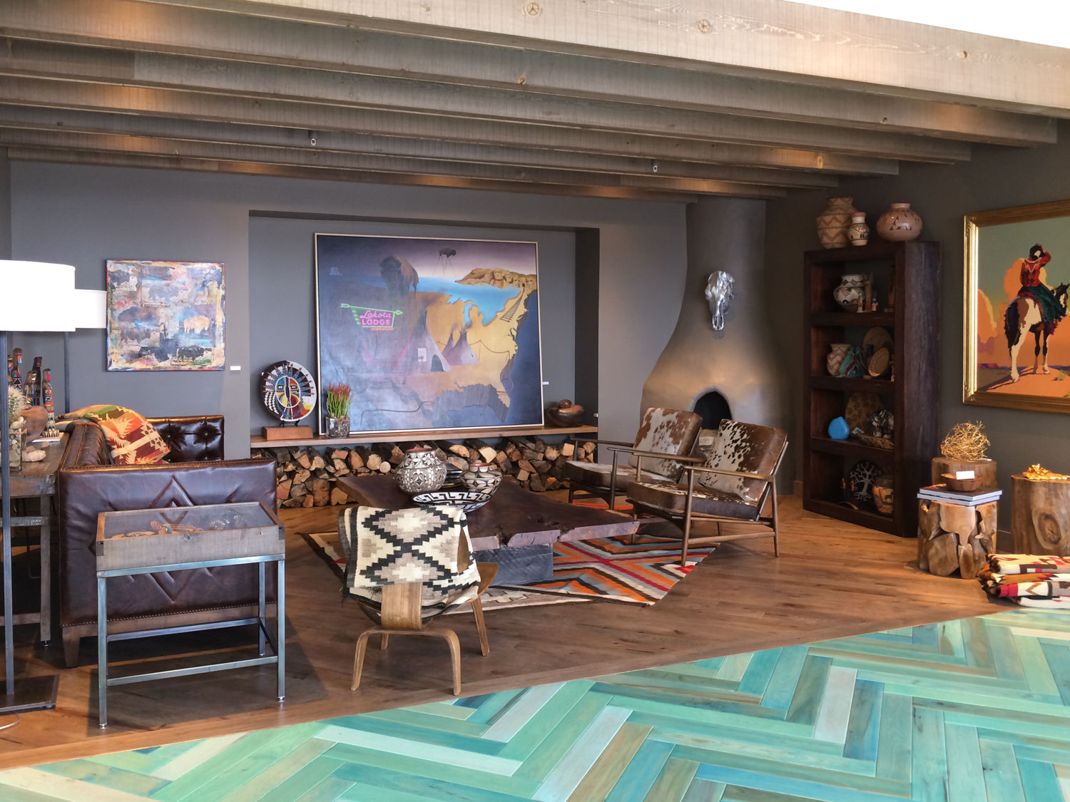 """Another angle of the Closing Room, showing the hand made """"kiva"""" fireplace."""