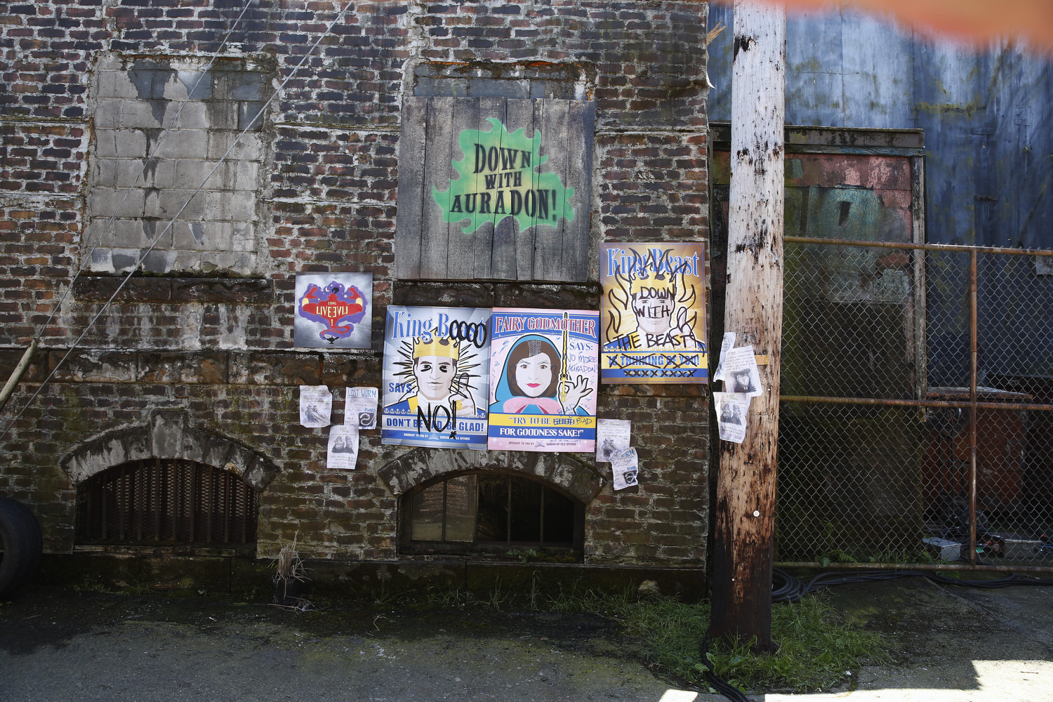 This is a detail of the cheerful and largely hopeless propaganda campaign the good people of Auradon paste up on the streets of the Isle in hopes of rehabilitating the fallen villains. In no time at all the people of the Isle make their feelings known.     © (DISNEY CHANNEL  /  Jeff Weddell)