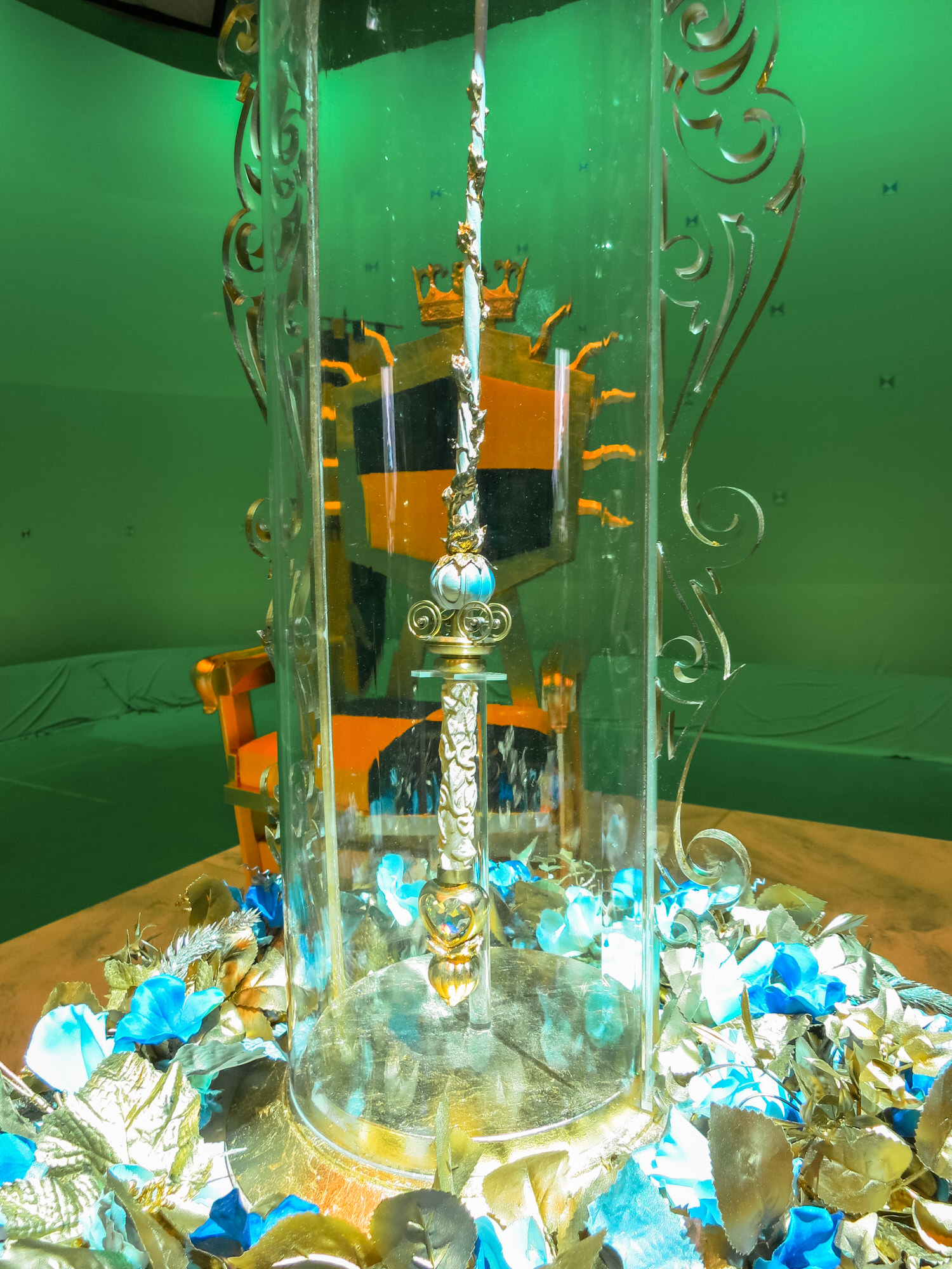 Fairy Godmother's all-powerful wand awaits the ceremony under it's enchanted glass bell.