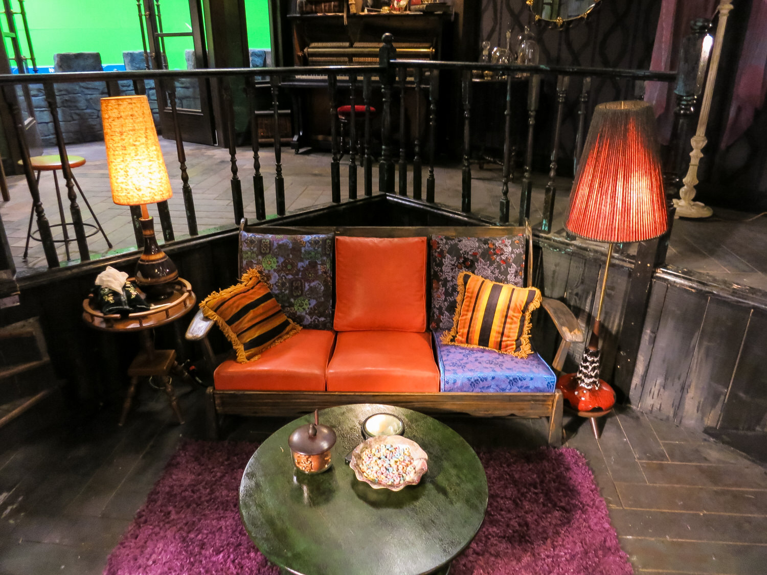 The mis-matched sofa in Maleficent's sunken living room.
