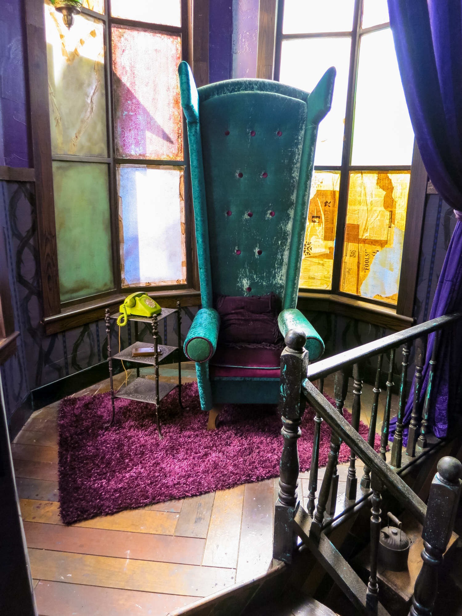 We wanted to give Maleficent one artifact from her former, magnificent life. The director suggested maybe her throne. Unfortunately the throne from the original animation was a 12 foot wide, 6 ton stone bat. Not a practical thing to carry into exile. So I tried to evoke the idea of that throne with a ridiculous green and purple wingback chair she might have confiscated from the Isle's Bazaar.