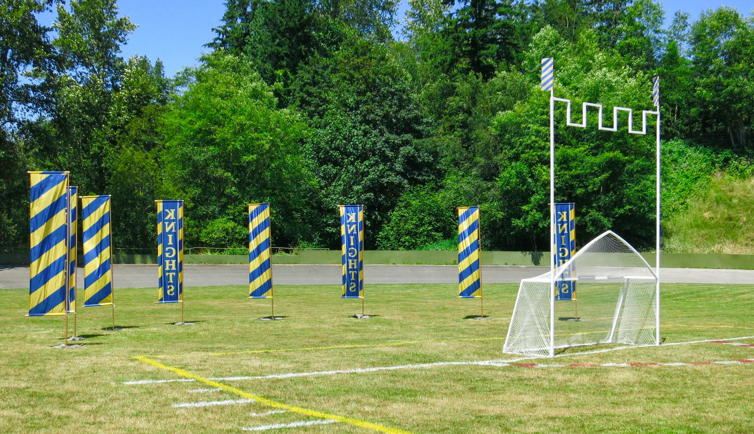 "Three points are scored hitting the ball into the net of the ""keep"", one point is scored by hitting the ball between the uprights under the castellations."