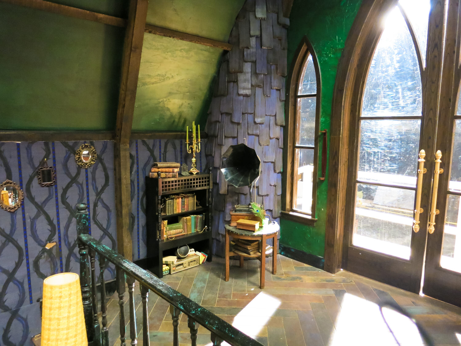 Maleficent's scratchy Victrola. Notice the double helix of the custom wallpaper. It evokes both Maleficent's classic thorn vine's from Sleeping Beauty and the idea of the DNA of evil. Does it pass from one generation to the next, or can one change their destiny?