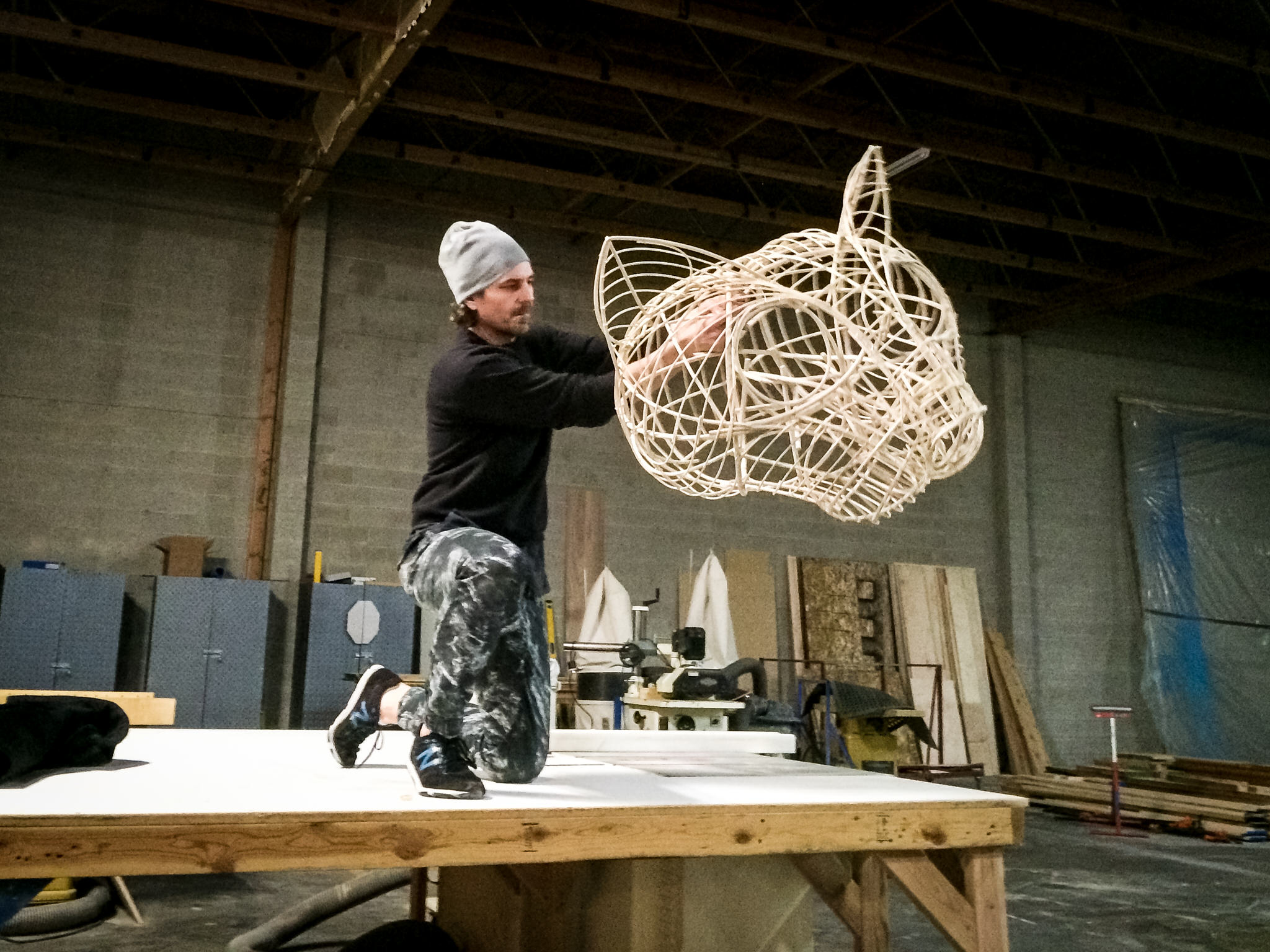 Since the actor would often be operating the head one-handed, it had to be light. I hadn't built a wicker piece since college, but it was obviously the right approach. Here Robert Scott Smith tries it out for the first time.