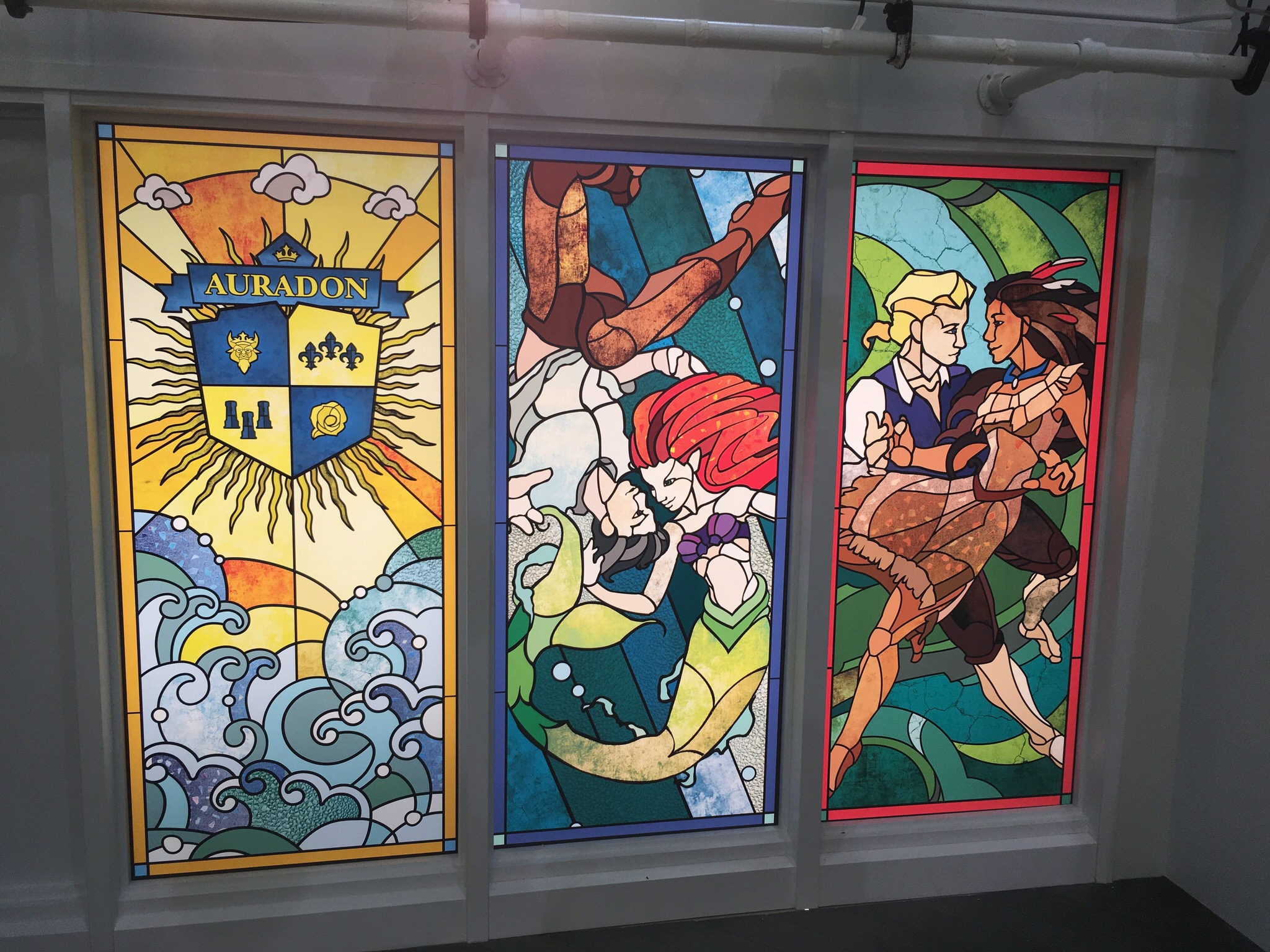 A detail of the stained glass windows on the yacht True Love, here celebrating The Little Mermaid and Pocahontas.