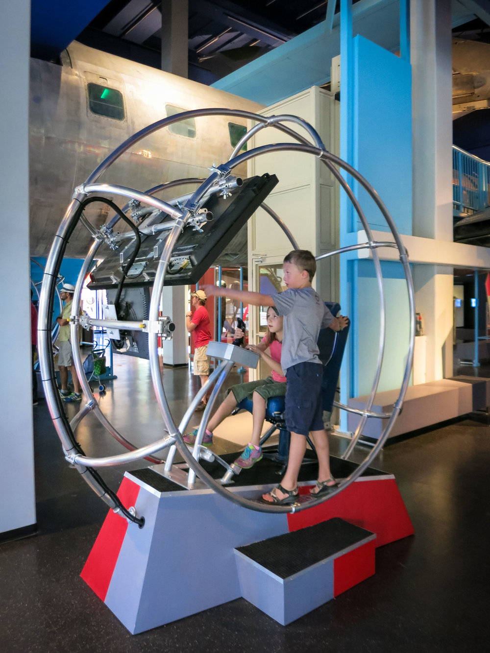 """We made two of these flight simulators. I feel that the """"cool"""" factor is still there, but the open design allows for much greater participation and group fun."""