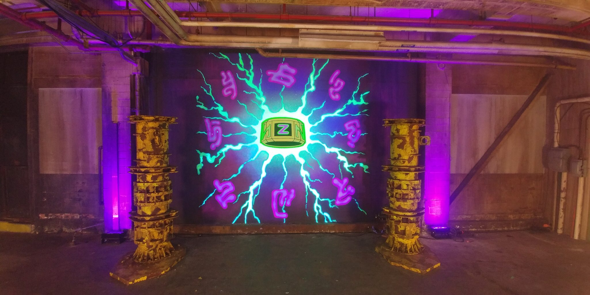 The Z-Band mural glowing in black light.