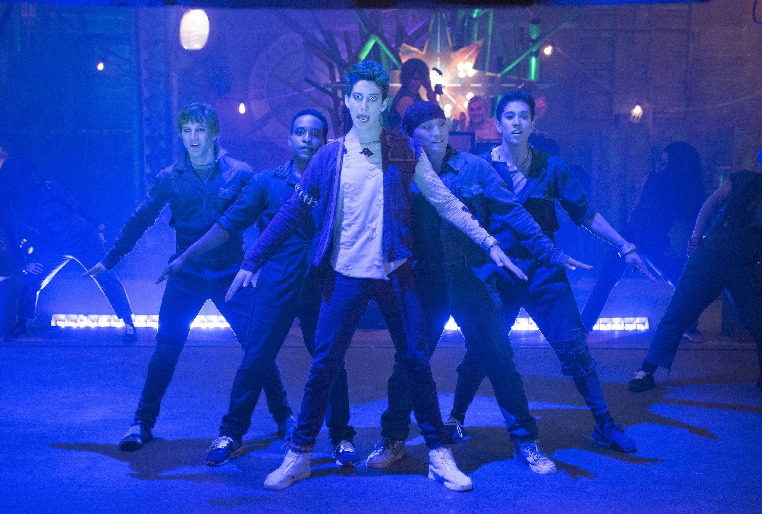 Zed (Milo Manheim) leads the zombie dancers in BAMM in the ruined energy plant.