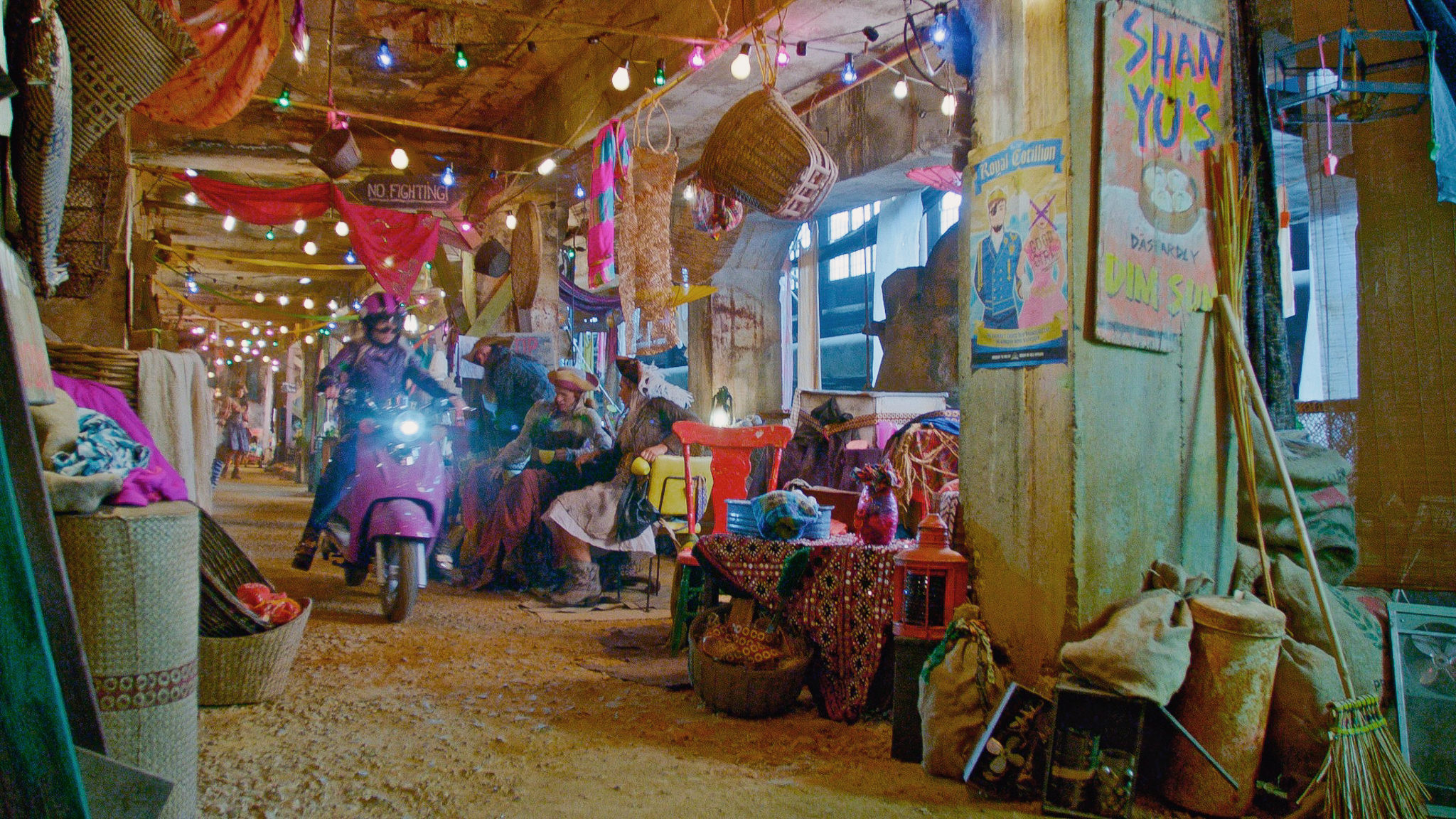 Mal (Dove Cameron) speeds through the Bazaar on her enchanted scooter on the Isle of the Lost.