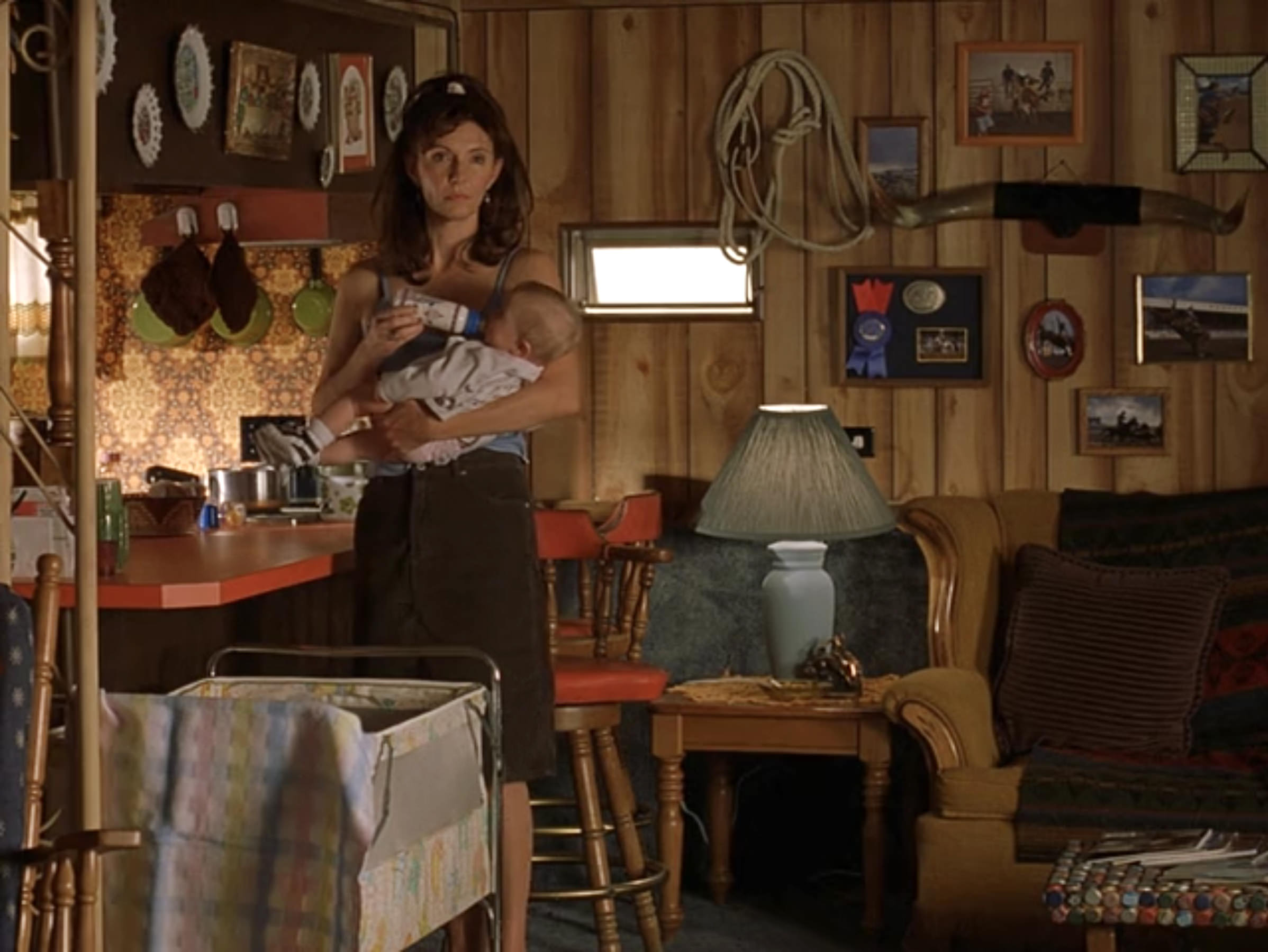 Estelle (Mary Steenburgen) in the kitchen/living room of Sonny's (Matthew Modine) trailer stage set.