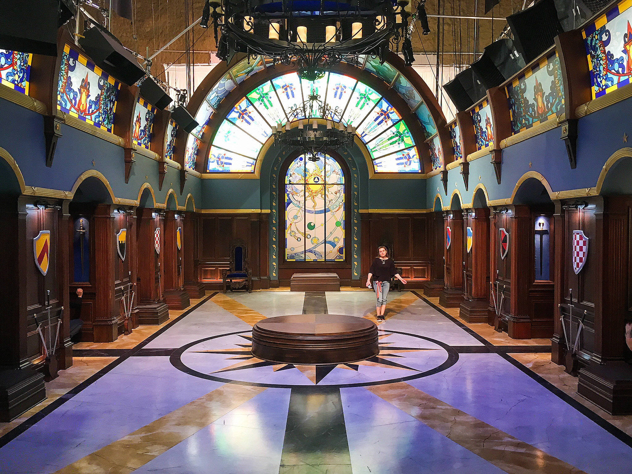 Disney's Descendants 3 takes place in both the wretched Isle of the Lost and the enchanted, perfected kingdom of Auradon. This is the armory in Auradon's royal palace. It houses a collection of armor and weapons (not pictured) that good-girl turned evil sorceress Audrey (Sarah Jeffrey) brings to life to fight our heroes in musical combat. We built this broad hall encased in stained glass.