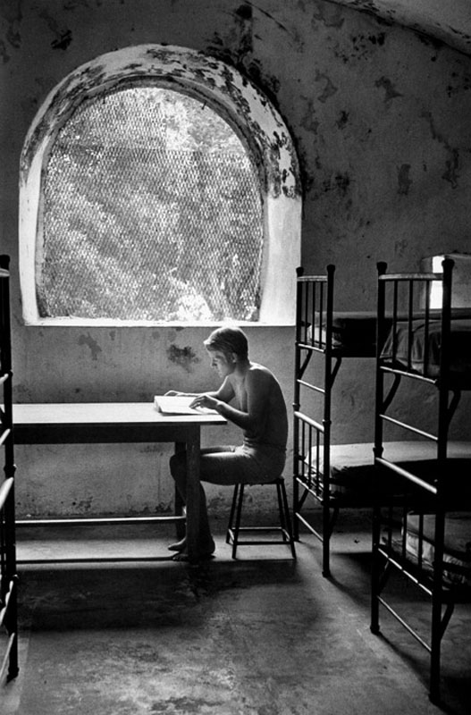 André Kertész, Young Man Seated Near Window, Martinique, 1972