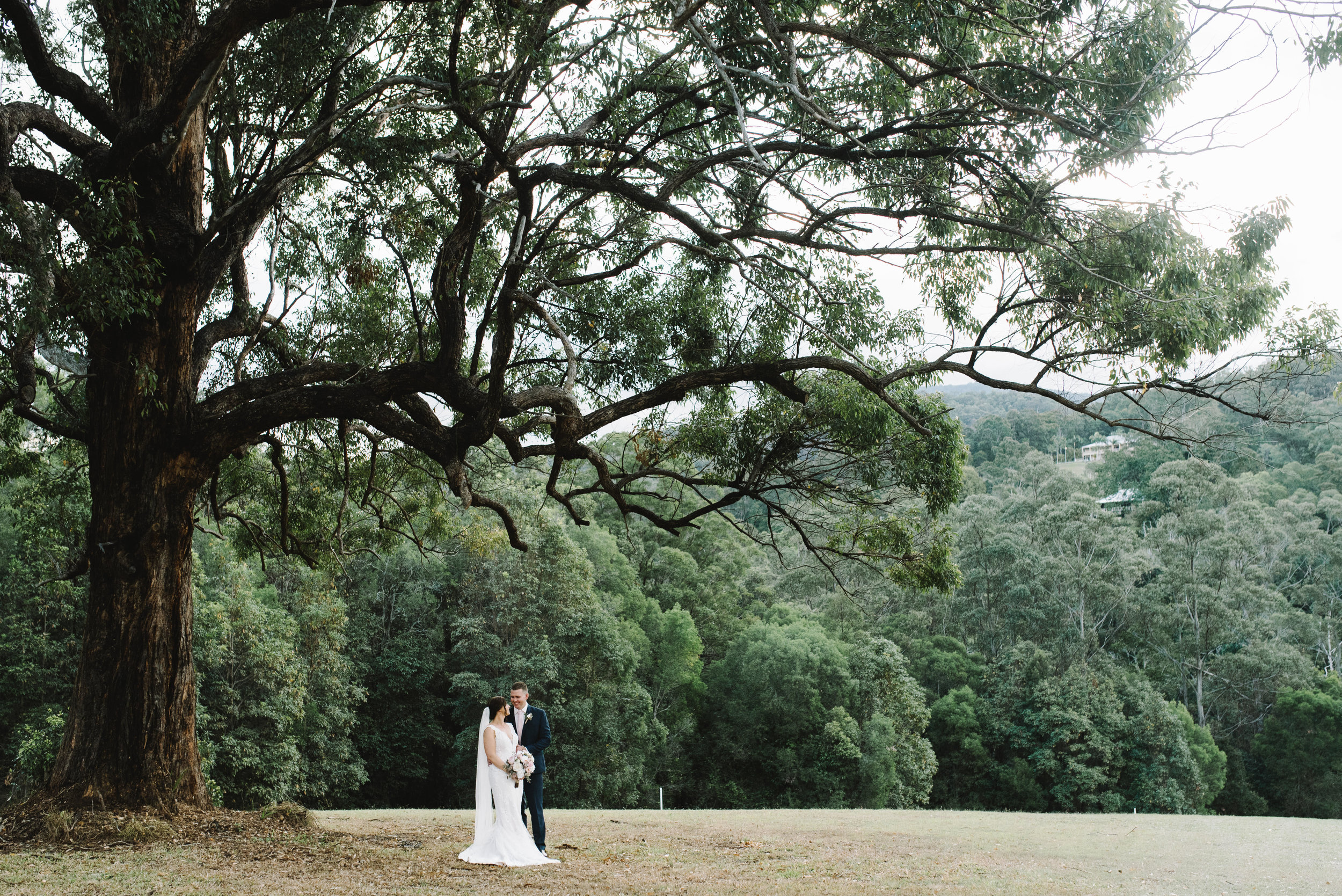 A 'posed' photo of Lauren + Chris on their wedding day at Austinvilla Estate.