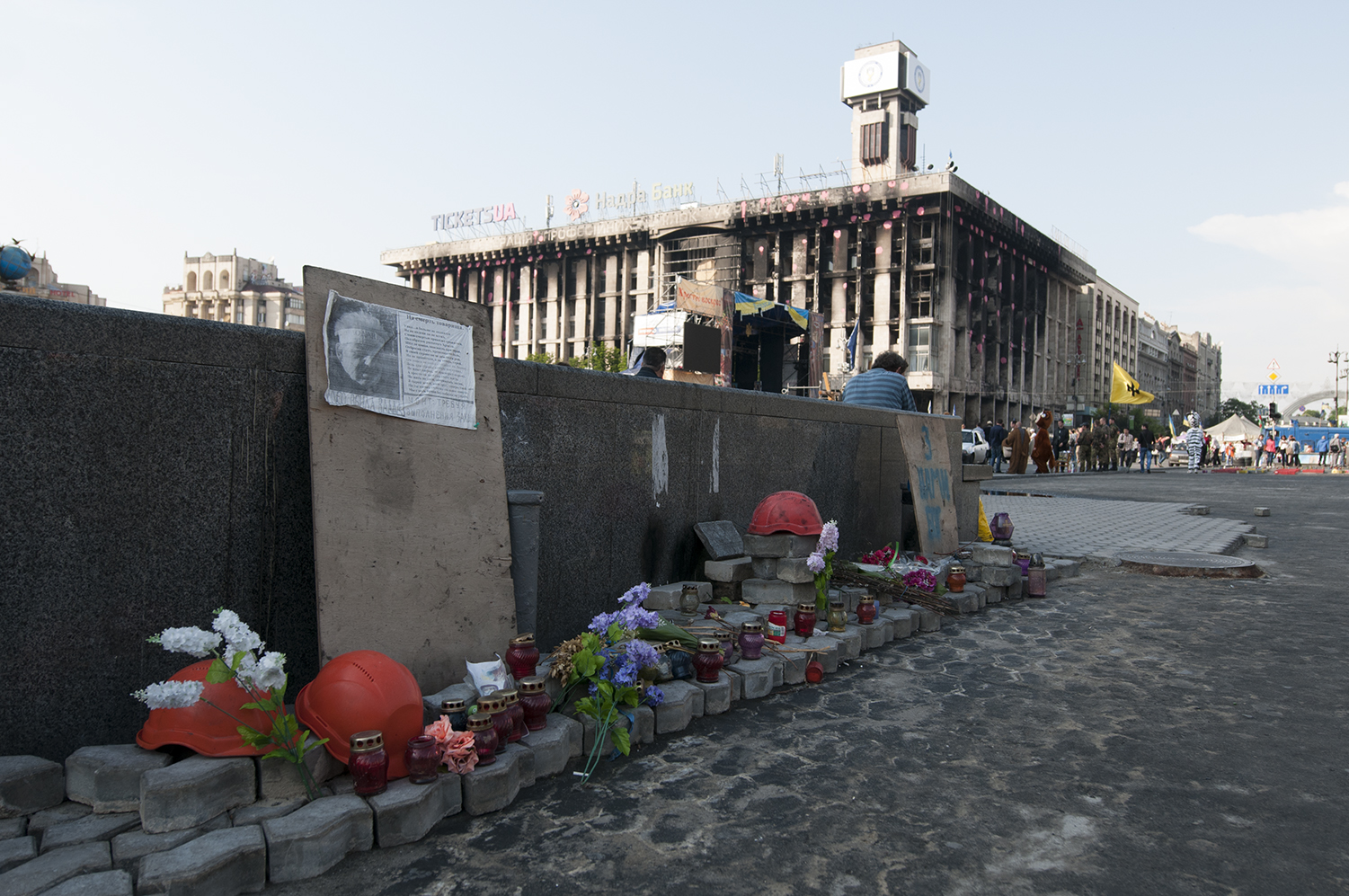 Memorial to one of the victims of the revolution standing against the Metro entrance