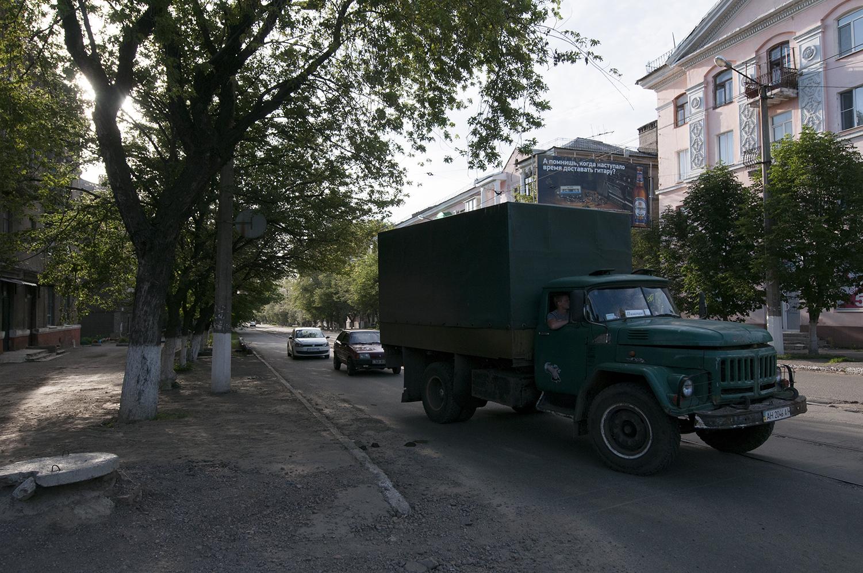 A camouflage truck driving throughHorlivka
