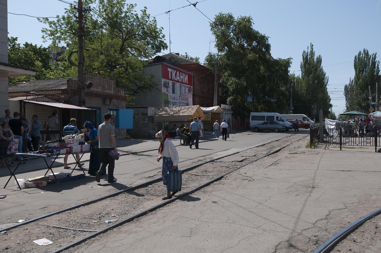 An elderly women crossing the tramway's rails in Mariupol
