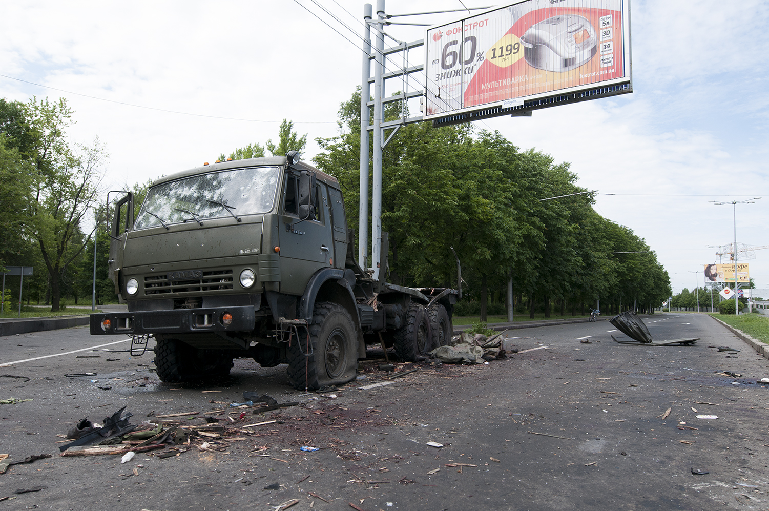 Destroyed transport truck full of bullet holes at theSBloddergey Prokofiev Airport