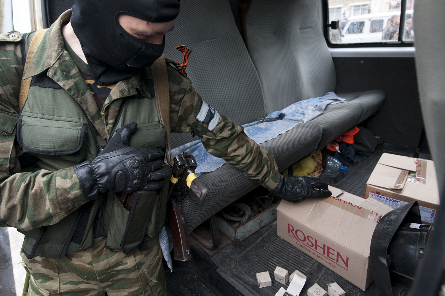 Solider showing of goods that have been stolen from a Roshen warehouse by a group of separatist the previous day