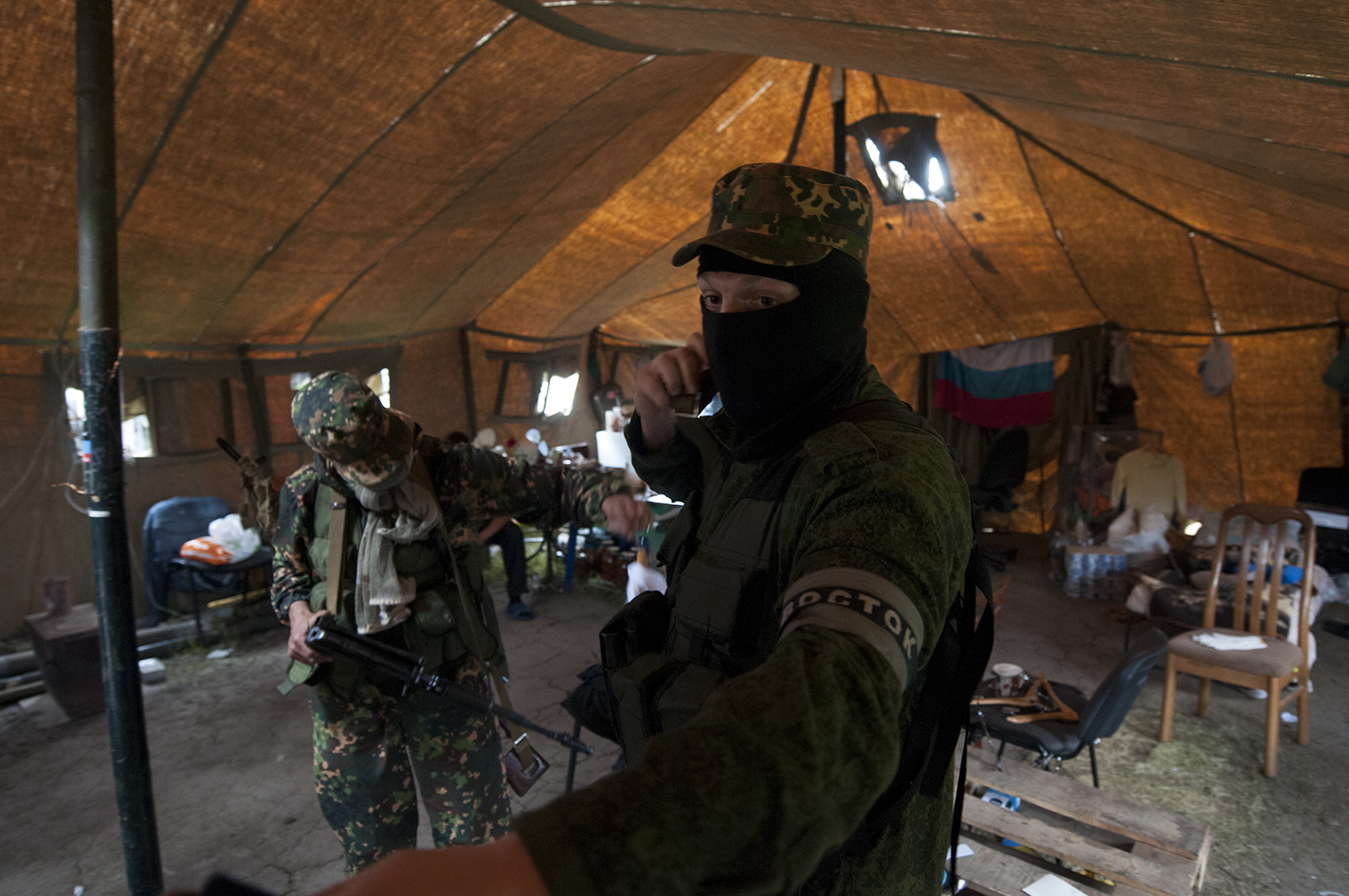 Soliders from the Vostok Battalion inside a tent located in front of the ODA