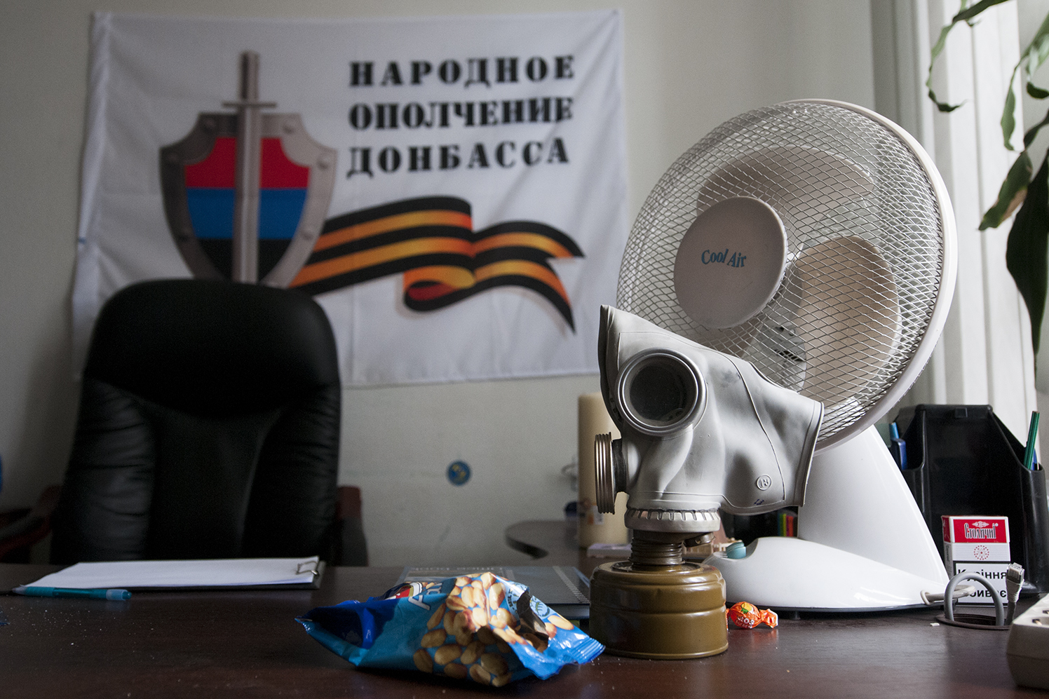 Gas mask and a peanut bag on a desk, ODA