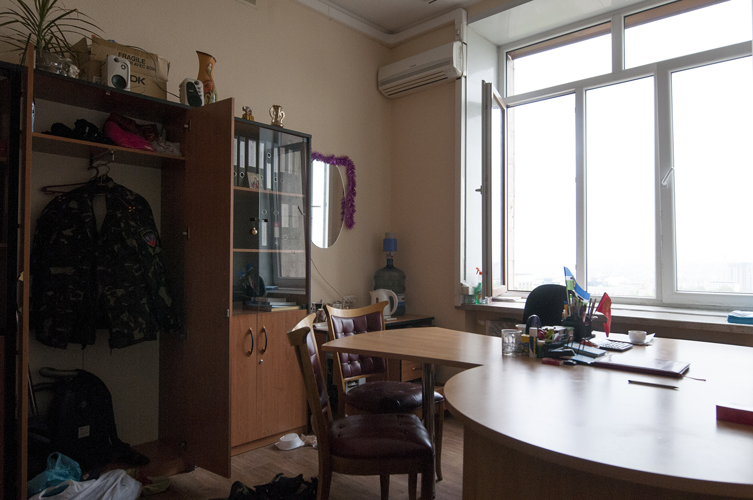 Uniform of a officer of the Donetsk People's Republic hanging in a closet, ODA
