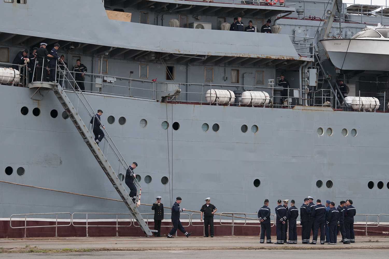 Russian sailors disembarking in Saint Nazaire to start their training on the Vladivostok, the first of the two Mistral warships sold by the French government to Russia . Its delivery is set for the last quarter of this year.