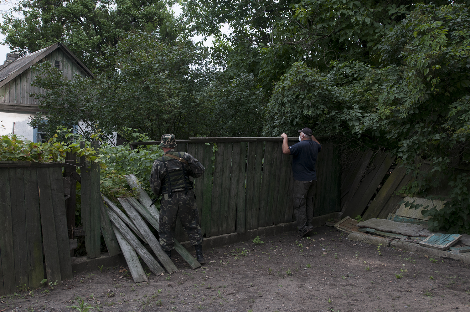 A separatist and a civilian looking checking the garden from which a really strong smell was coming out