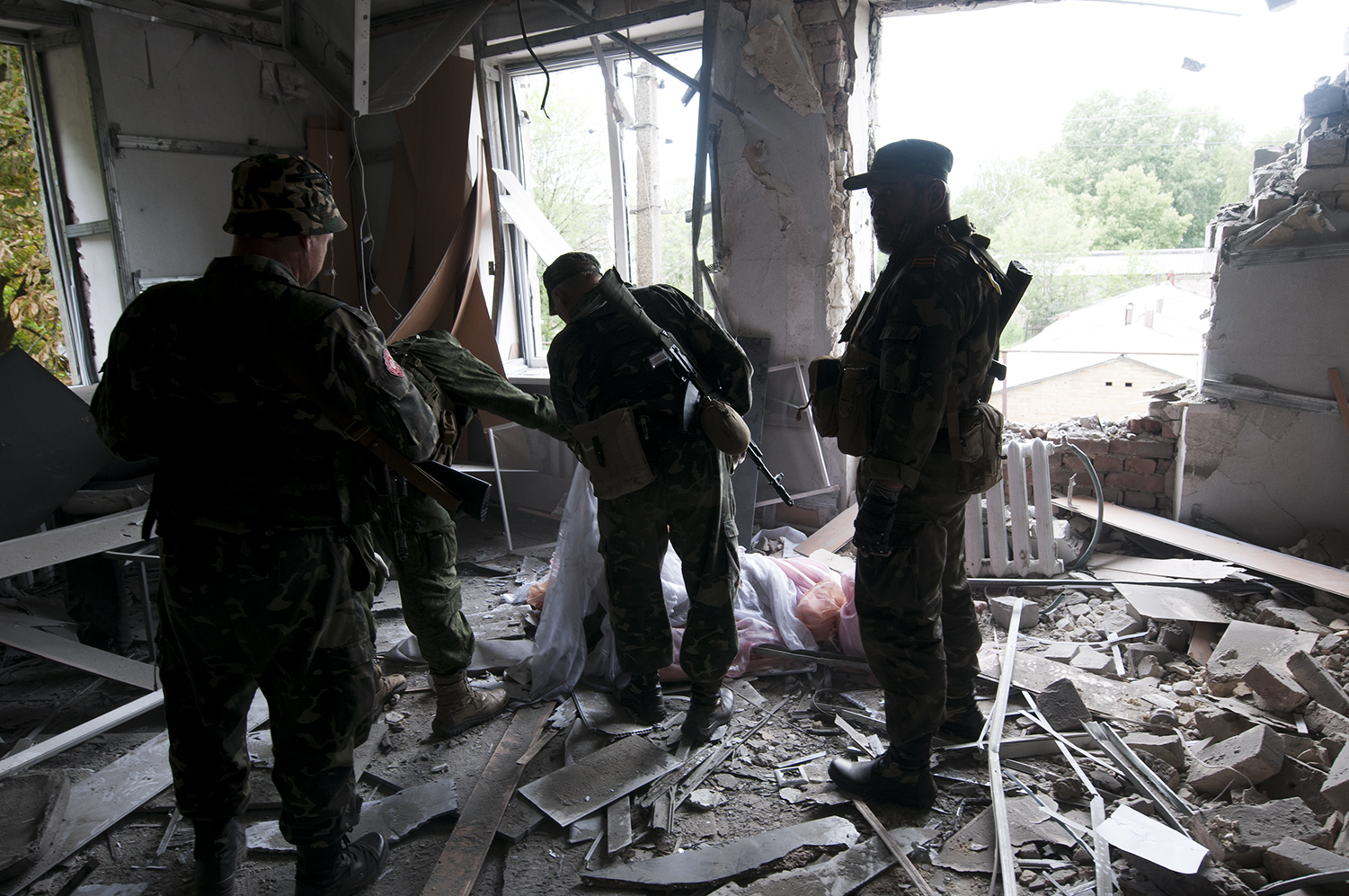 Separatist squad looking over the life less body of a security guard they came to retrive