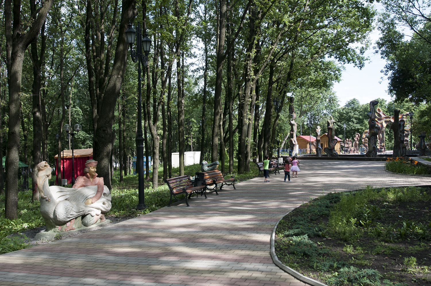 Children walking around in the nearly empty park surrounding the Dombass Arena in the center of Donetsk