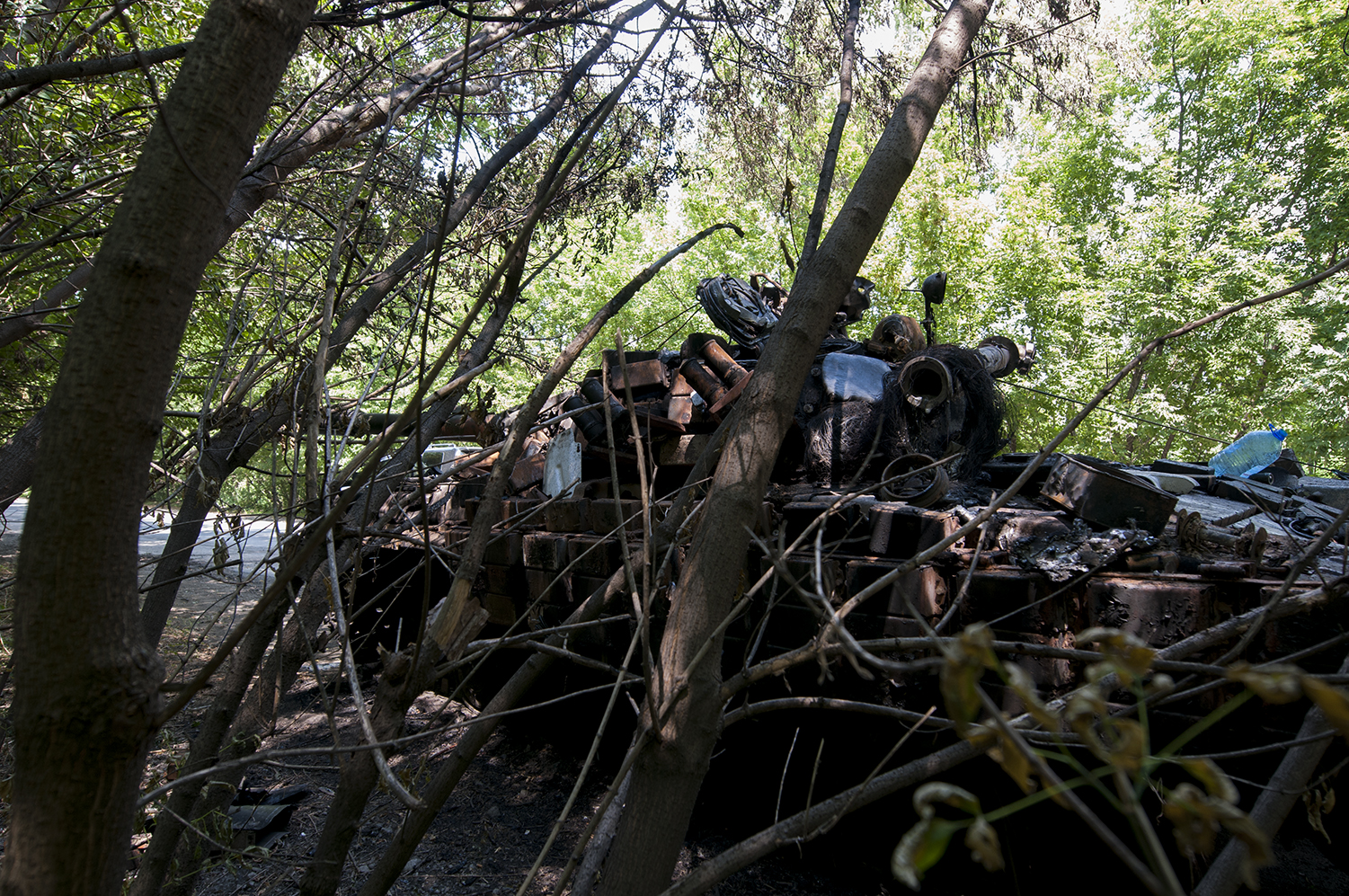 Destroyed unmarked tank on the edge of Donetsk