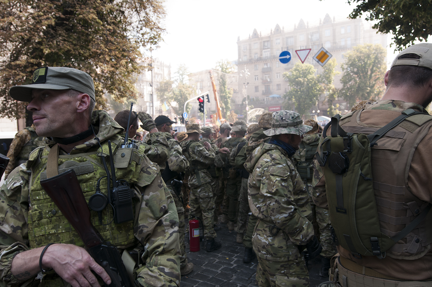 Soldiers from the National Guard being pushed back from Maidan