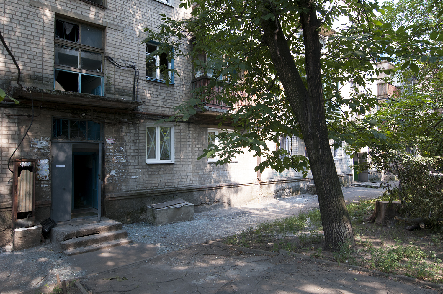 Scatteredglass which have been blown away by the shelling that took place during the evening of the 9th August in the north part of Donetsk