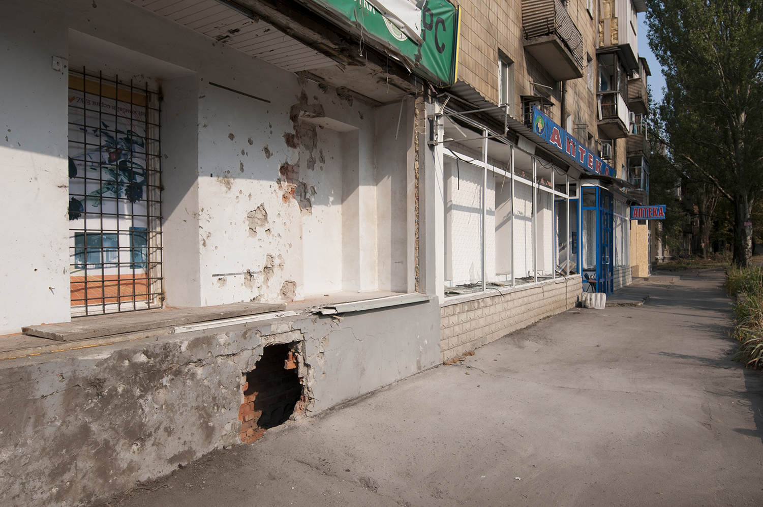 Store damaged by the blast of a shell