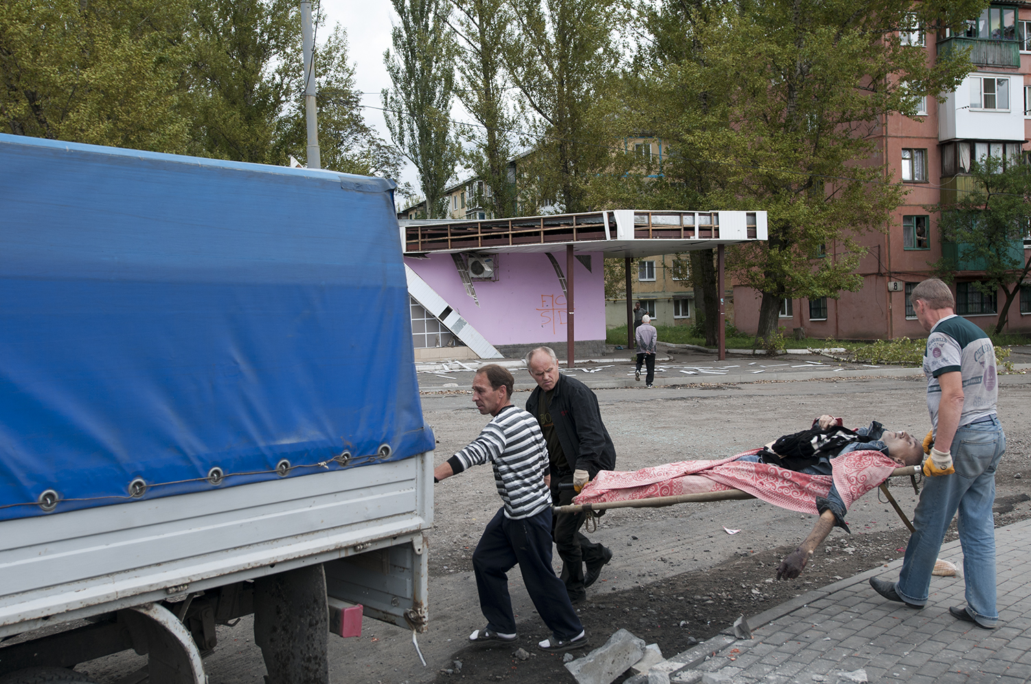 Volunteers loading the corps inside the back of their truck