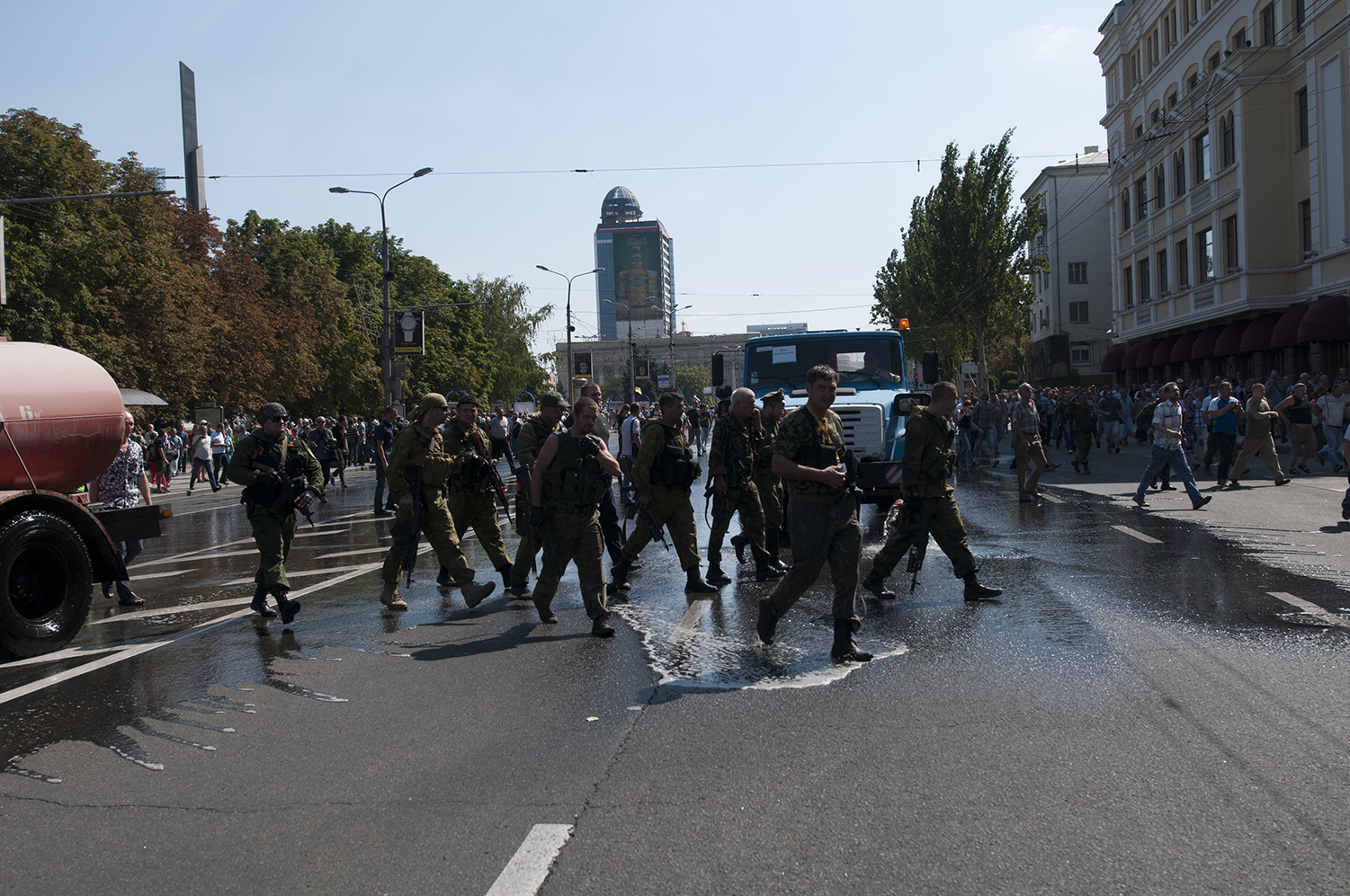 Pro-Russian rebels walking carelessly after their prisoners