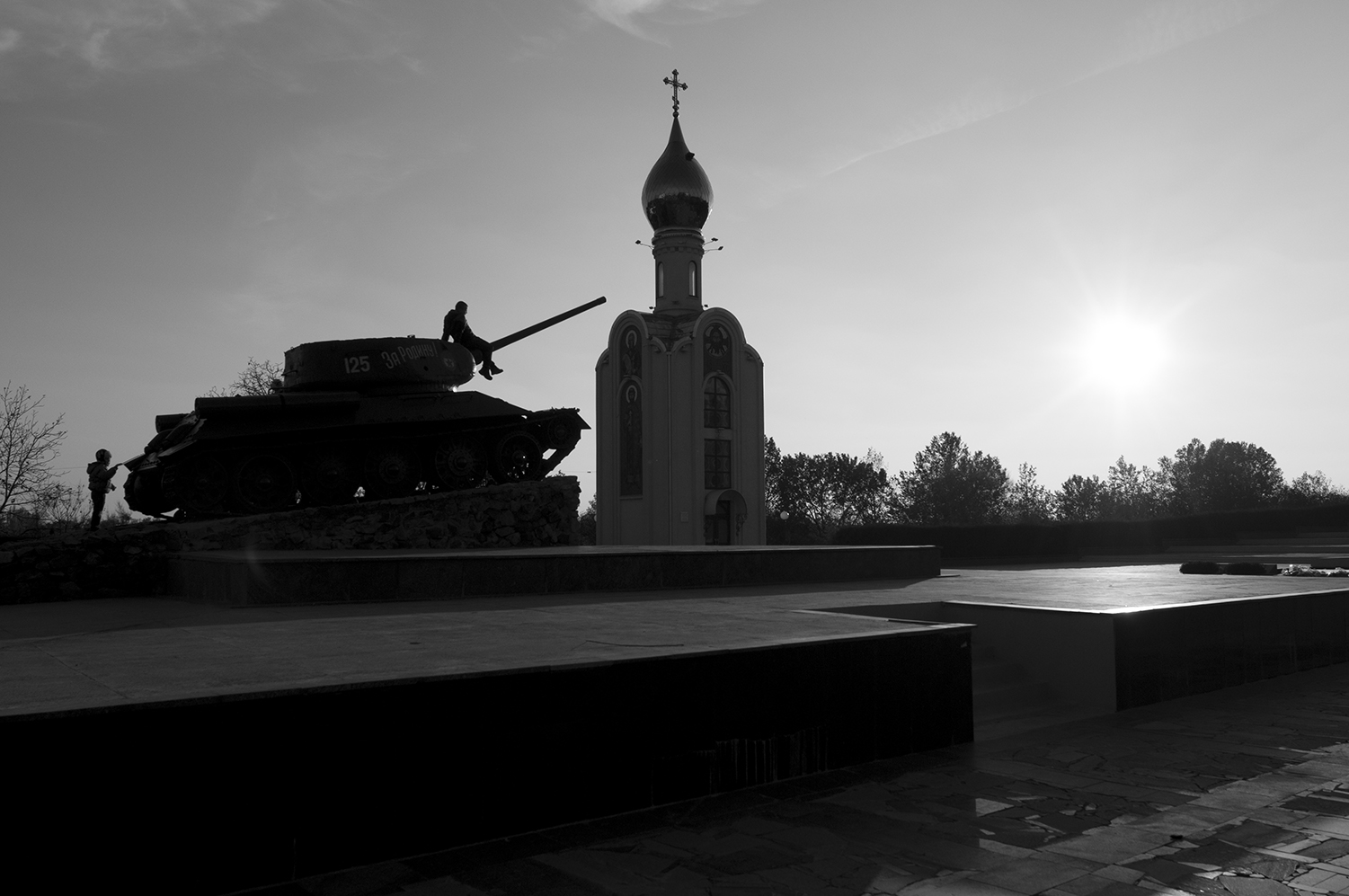 Kids playing on a T-34, memorial for World War Two.