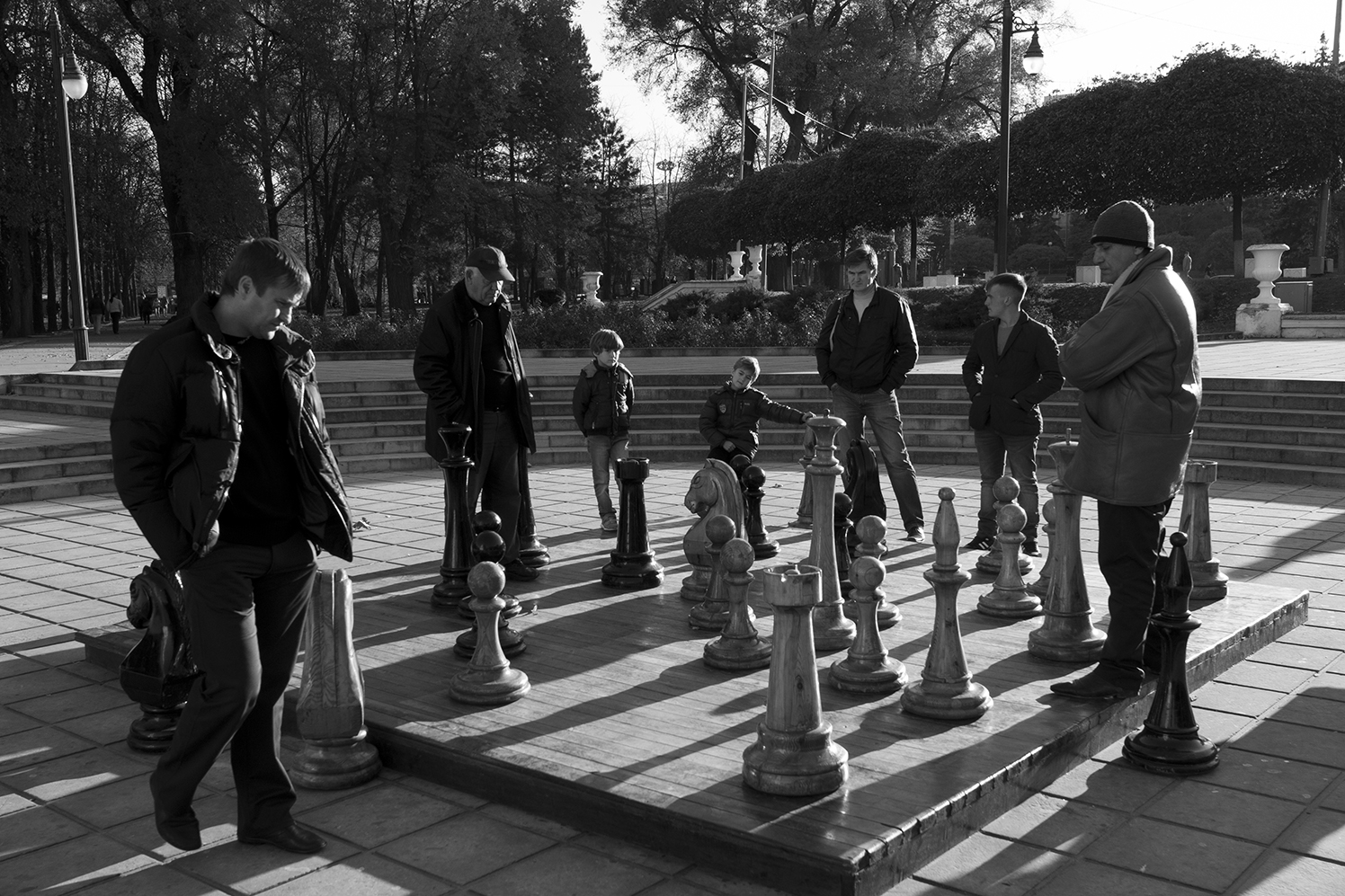 People playing on a giant chess game in the entrence ofNativity Cathedral Park