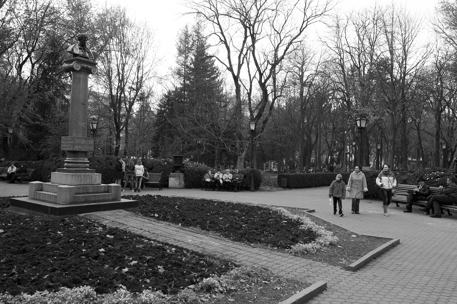 Young kid looking up at the bust of Pushkin