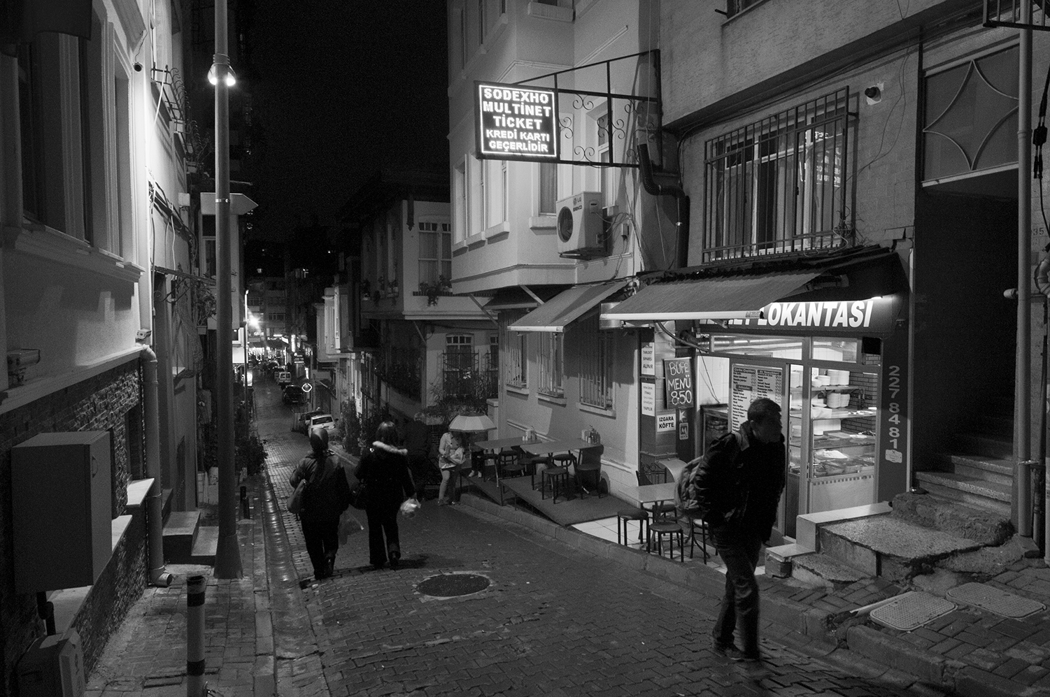 People strolling down the street of the  Beyoğlu district   at night